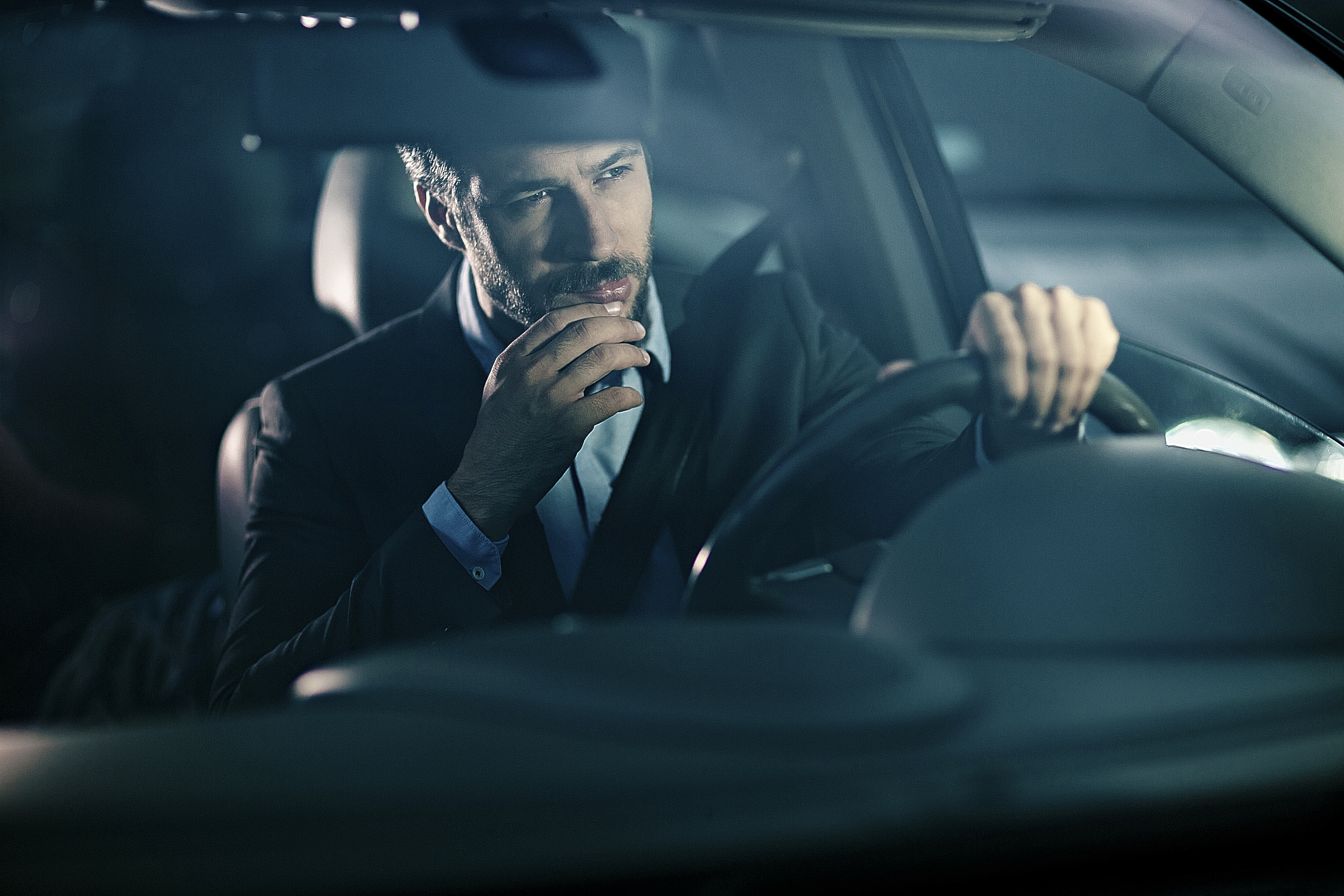 car shopper contemplating affordable luxury vehicle